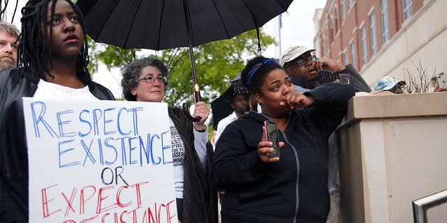 In this May 3 photo, people listen to speakers at the Edmond Police Department during a Black Lives Matter rally. (Sarah Phipps/The Oklahoman via AP File)