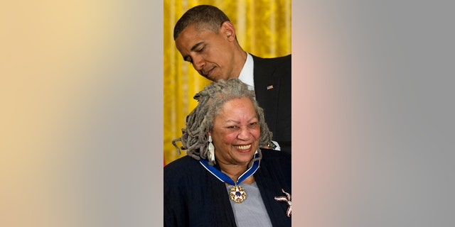 FILE - In this May 29, 2012 file photo President Barack Obama awards author Toni Morrison a Medal of Freedom during a ceremony in the East Room of the White House in Washington. Publisher Alfred A. Knopf says Morrison died Monday, Aug. 5, 2019 at Montefiore Medical Center in New York. She was 88. (AP Photo/Carolyn Kaster, File)