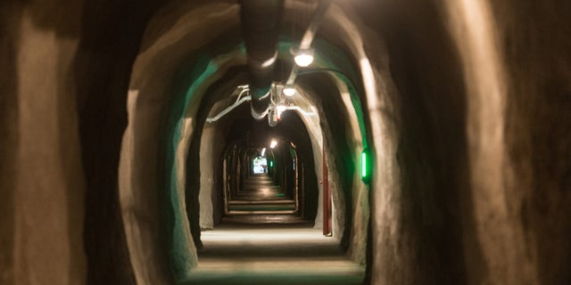 DARPA solicited information on underground lairs in a recent tweet. The above image shows the inside of the Barbara Tunnel in Oberried, Germany. The tunnel has been the central long-term archive of Germany since 1975.