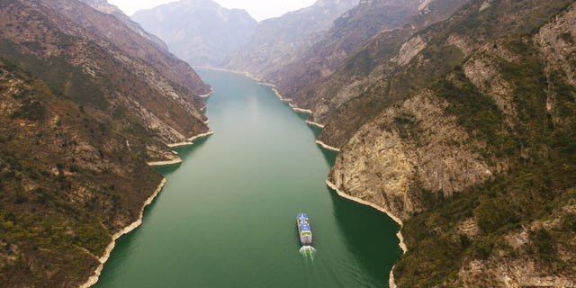 A ship sails in the Wuxia Gorge, one of the Three Gorges on the Yangtze River, in Wushan County, southwest China, back in March.  (Xinhua/ via Getty Images)