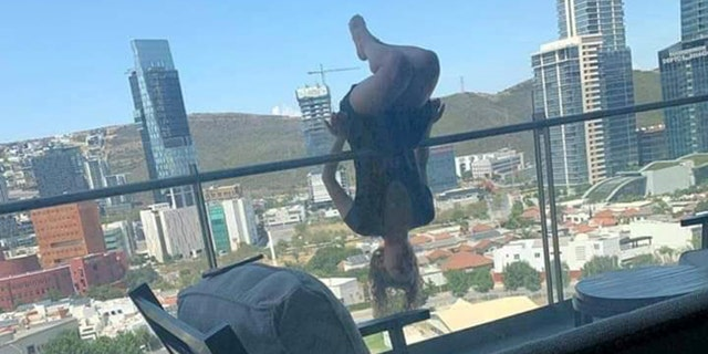 Woman plummets from balcony after attempting extreme yoga pose