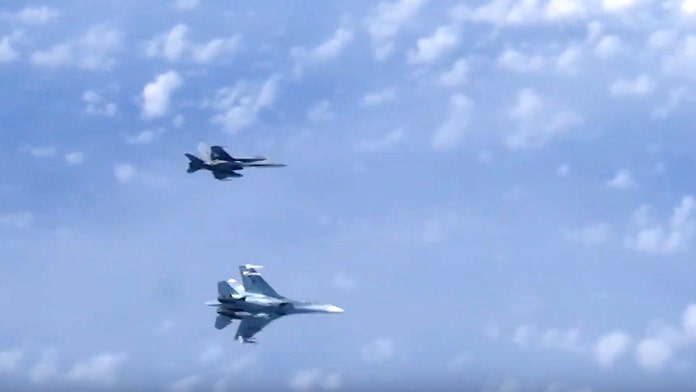 Russian fighter jet chases off NATO warplane approaching plane carrying Russian Defense Minister over neutr...