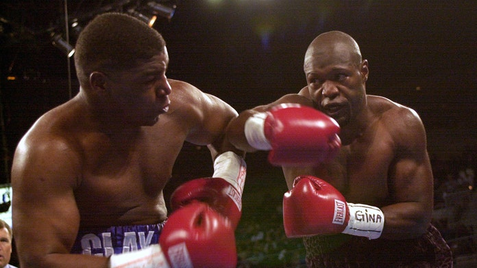 Former boxing star Clifford Etienne says he's cutting hair and painting in prison