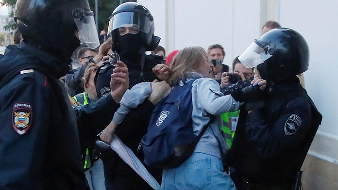 Russian police caught on camera punching female protester in stomach