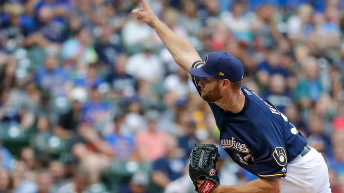 Milwaukee Brewers' Adrian Houser throws up during game, hurls 10-strikeout gem