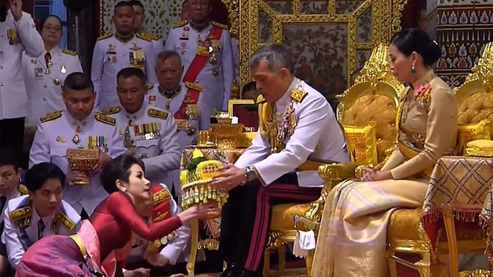 Thai king names mistress official concubine in ceremony alongside new wife of 3 months