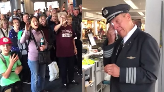 Pilot in tears after choir surprises him on his retirement flight: 'May God hold in you the palm of His hand'