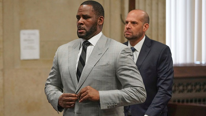 R. Kelly fails to appear for Chicago court date, prosecutors allege he 'refused transport'