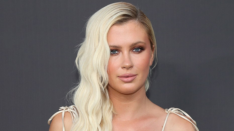 Ireland Baldwin covers breasts with 'I voted' stickers ahead of the 2020 presidential election