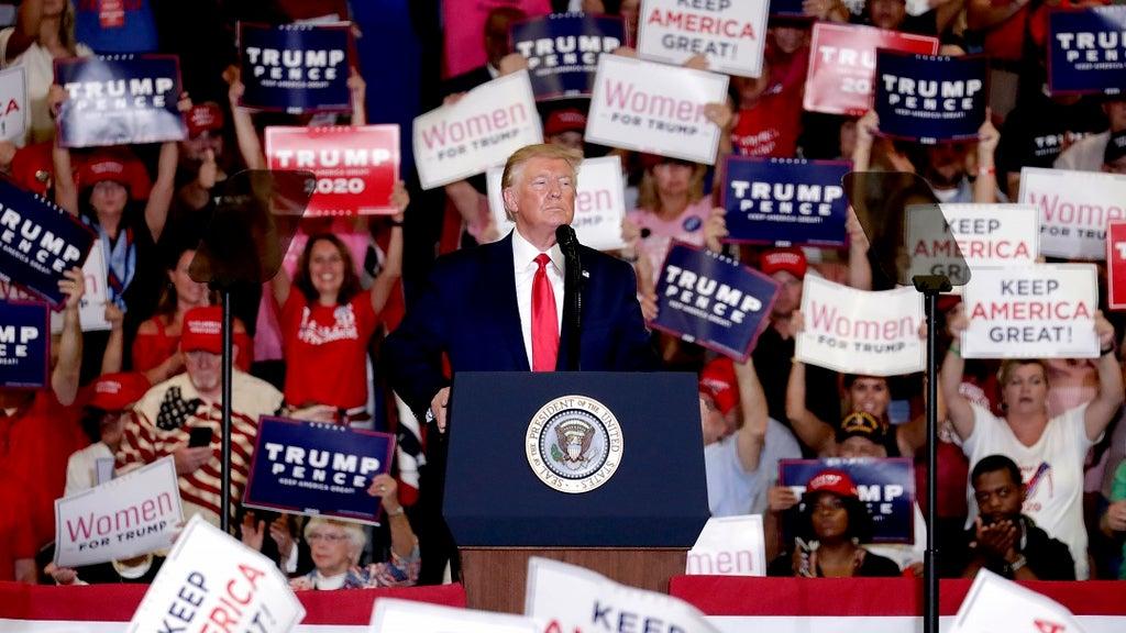 HS cancels football game amid uproar over cheerleaders' pro-Trump banner