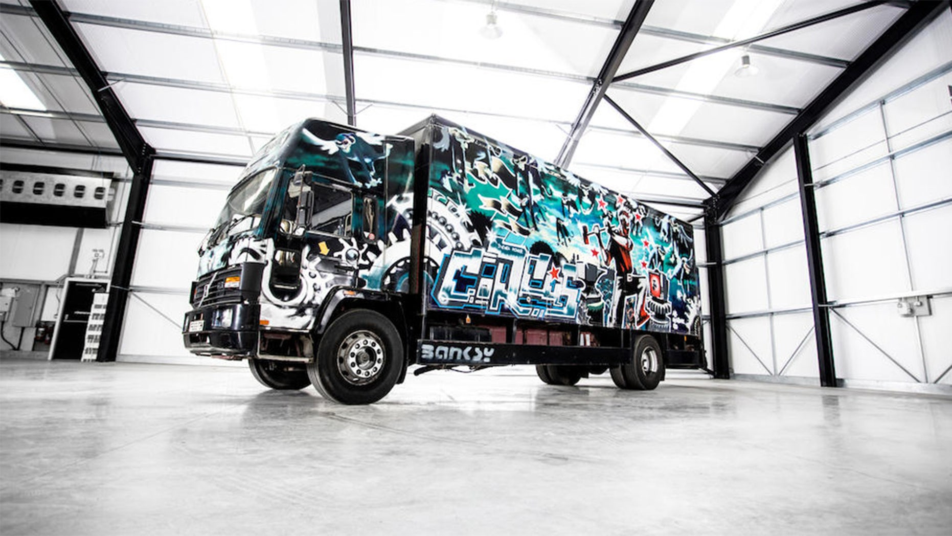 Volvo van painted by Banksy
