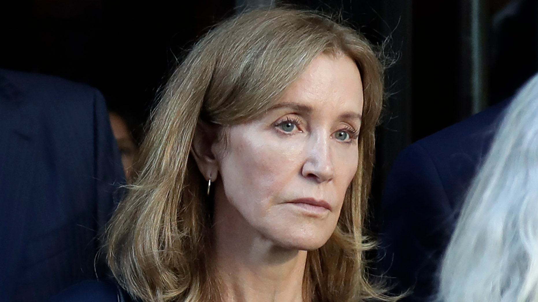 Felicity Huffman leaves federal court after her sentencing in a nationwide college admissions bribery scandal, Friday, Sept. 13, 2019, in Boston. (AP)
