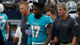Miami Dolphins' Allen Hurns takes two brutal blows to the head on one play