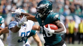 Philadelphia Eagles' Miles Sanders has helmet ripped off on kick return