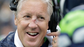 Seattle Seahawks' Pete Carroll receives nasty gash to nose after getting hit with football