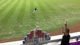 Miami Marlins' Austin Dean shows off dead aim in delivering perfect throw at fans' beer can pyramid