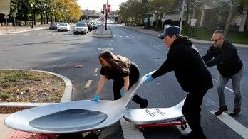 Artist brings 800-pound opioid spoon to Johnson & Johnson's doorstep