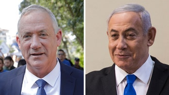 Israeli exit polls show Netanyahu short of majority in year's second election