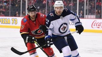 Winnipeg Jets' Mark Letestu raises eyebrows as he devours condiment on bench