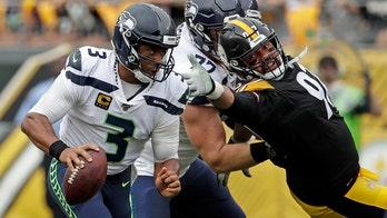 Seattle Seahawks' Russell Wilson takes huge hit to helmet during game