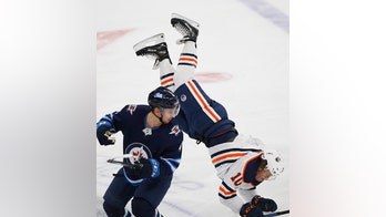 Winnipeg Jets' Neal Pionk sends Edmonton Oilers' Joakim Nygard airborne with open-ice hit