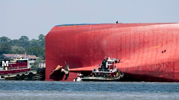 Coast Guard has freed all 4 crew members from capsized cargo ship: officials