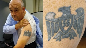 White ATF supervisor with Nazi arm tattoo discriminated against black agent, lawsuit claims