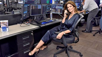 Cindy Crawford mans phones for 9/11 charity