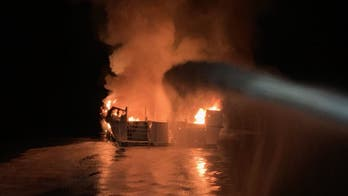 Safety deficiencies suspected in deadly dive boat fire; Dorian weakens as 'Sharpiegate' rages