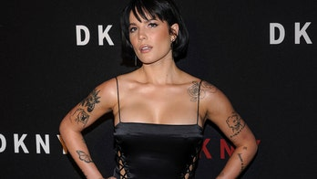 Halsey strikes a pose in double hip-high slits at DKNY's New York Fashion Week event