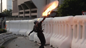 Hong Kong police deploy water cannons amid clashes with protesters in 15th consecutive weekend of unrest