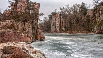 Minnesota woman survives more than 80-foot fall down South Dakota cliff, officials say