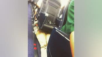 Passenger shamed for resting under plane seats: 'This is so nuts'