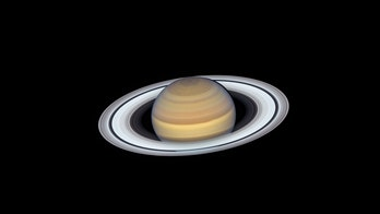 Age of Saturn's rings debated as questions about life emerge