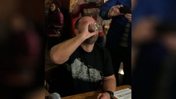 Crowd cheers as man drinks 'Sourtoe Cocktail' made with his own amputated toe