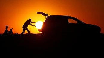 Amazing photos depict man loading the sun into his SUV