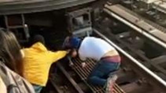 5-year-old rescued after dad jumps in front of Bronx train with her: video