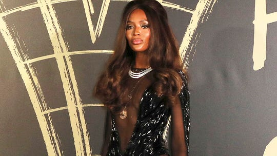 Naomi Campbell stuns in sheer, low cut gown at London Fashion Week
