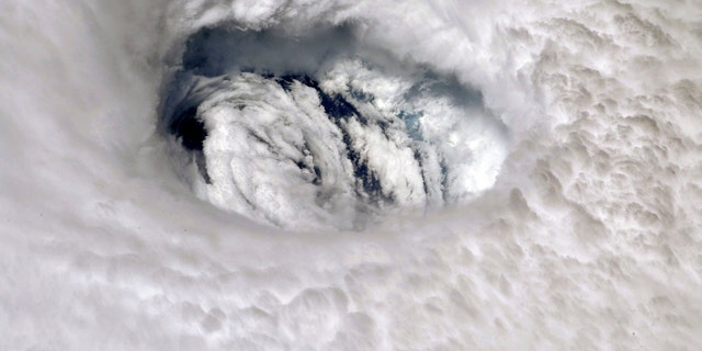 This Sept. 2, 2019 photo provided by NASA shows the eye of Hurricane Dorian shown from the International Space Station.