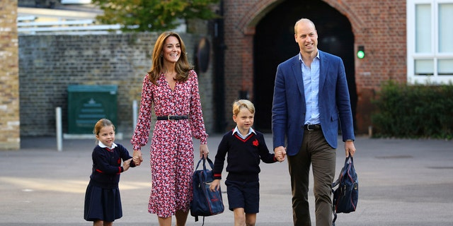 Britain's Princess Charlotte, left, with her brother Prince George and their parents Prince William and Kate, Duchess of Cambridge, arrives for her first day of school at Thomas's Battersea in London, Thursday Sept. 5, 2019.