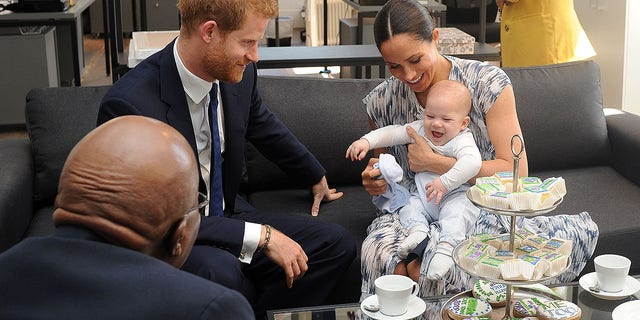 Britain's Duke and Duchess of Sussex, Prince Harry and his wife Meghan Markle hold their baby son Archie as they meet with Archbishop Desmond Tutu at the Tutu Legacy Foundation in Cape Town on Sep. 25, 2019.