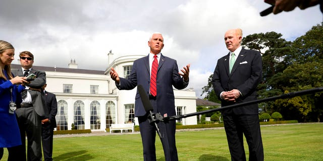 Pence Vice President and US Ambassador to Ireland Edward Crawford speak at the ambassador's residence in Dublin on Tuesday. (AP Photo / Peter Morrison)