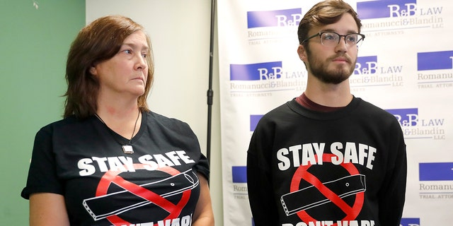 Adam Hergenreder, right, and his mother Polly, attend a news conference where their attorney announced the filing of a civil lawsuit against e-cigarette maker Juul on Hergenreder's behalf Friday, Sept. 13, 2019, in Chicago. (Associated Press)