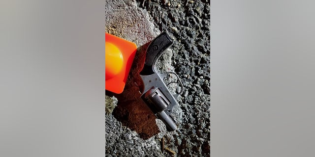 In this photo provided by the New York City Police Department, a handgun recovered at the scene of the shooting. (NYPD via AP)