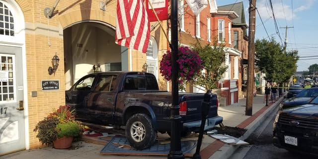 A man rammed his truck into the Taneytown City Hall in Maryland because the city shut his water off after he failed to pay his bill, the mayor said.