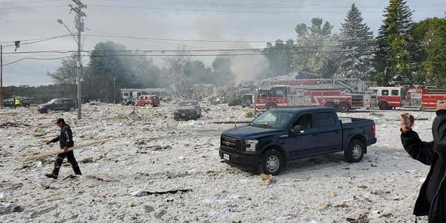 A building explosion in Farmington, Maine, left at least one firefighter dead and six other people injured, officials said.