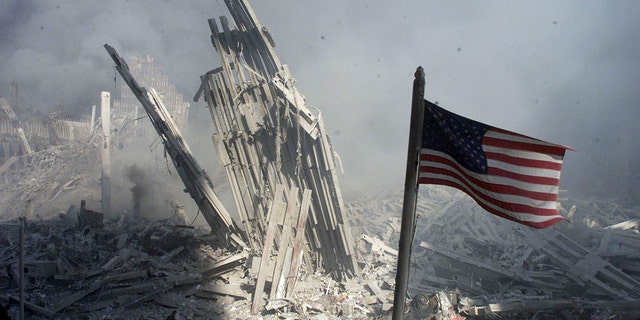 An American flag flies near the base of the destroyed World Trade Center in New York, in this photo from September 11, 2001, taken after the collapse of the towers. (REUTERS/Peter Morgan-File)