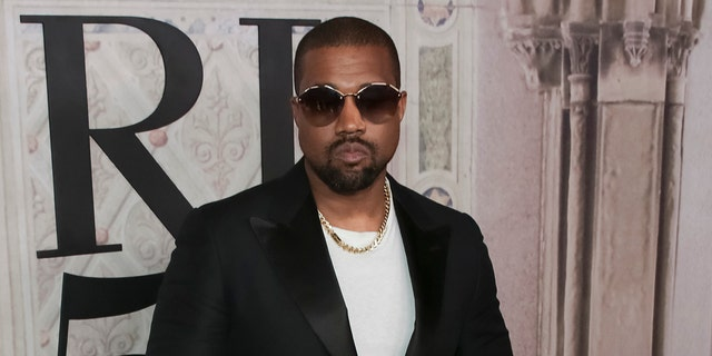 Westlake Legal Group AP-Kanye-West-Service Kanye West addresses Kim Kardashian backlash after he commented on wife's 'sexy' clothes Tyler McCarthy fox-news/person/kanye-west fox-news/entertainment/kardashians fox-news/entertainment/genres/reality fox-news/entertainment/events/marriage fox-news/entertainment/events/feud fox-news/entertainment/celebrity-news fox news fnc/entertainment fnc article 60d6a5ab-4aa8-5b39-93ec-436c39dccd4d