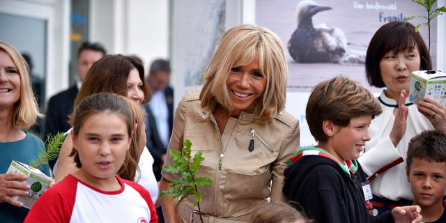 French first lady Brigitte Macron, wife of French President Emmanuel Macron, meets surfers at the Cote des Basques beach during the G7 summit, in Biarritz, southwestern France, Monday Aug. 26 2019.