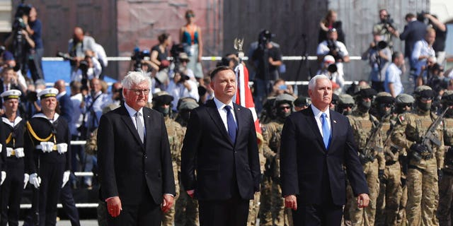 U.S. Vice President Mike Pence, right, Polish President Andrzej Duda, center and German President Frank-Walter Steinmeier stand during a memorial ceremony marking the 80th anniversary of the start of World War II in Warsaw, Poland, Sunday, Sept. 1, 2019. (AP Photo/Petr David Josek)